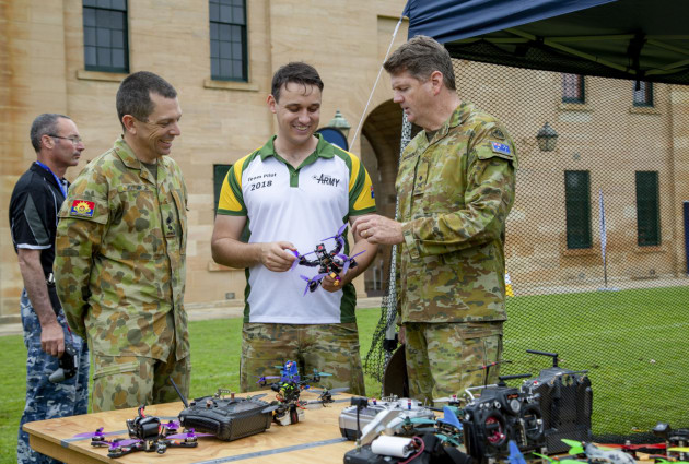 Captain James Jenkins (middle), takes Lieutenant Colonel Keirin Joyce (left), and Commander Forces Command Major General Gus McLachlan (right), through different components of a drone. Defence