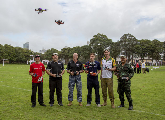 L-R: British Army member, Gunner Liam Seckam; New Zealand Army soldier, Sergeant Garry Wilson; Royal Australian Air Force member, Corporal Steven Duncan; Royal Navy sailor, Able Seaman James Payne; Australian Army soldier, Lance Corporal Cameron Webster; and Royal Thai Army soldier, Corporal Metha Yupanit; practice drone flying techniques together during the International Drone Racing Tournament at Victoria Barracks, Sydney. Defence