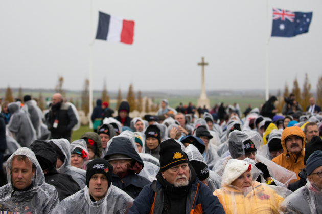 Members of the public brave the cold weather during the commemorative service for the centenary of the First World War Armistice, Australian National Memorial, Villers-Bretonneux, France. Defence