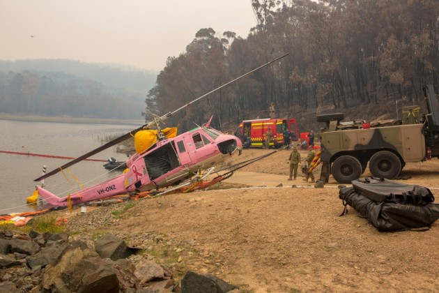 An Australian Army Heavy Recovery Vehicle is used to recover a NSW Rural Fire Service-contracted helicopter that ditched in the Ben Boyd Reservoir near Eden, NSW. Photo: Sergeant Bill Solomou