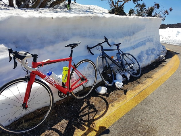 Despite the thick snow along the side of the climb the pre-summer days can get warm in the Snowy Mountains – prepare for all weather!