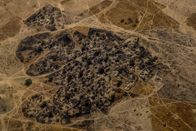 A burned Nigerian village seen from a United Nations helicopter flying between Maiduguri and Monguno. Villages have been razed and burned by both Boko Haram and the Nigerian Military throughout the region. © Ashley Gilbertson, Australia, Shortlist, Professional, Landscape (Professional competition), 2018 Sony World Photography Awards