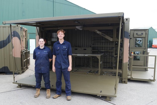 Varley workers pose before one of the 22 Deployable Duty Facilities built under the sub-contract to Lockheed Martin. Credit: Varley Group