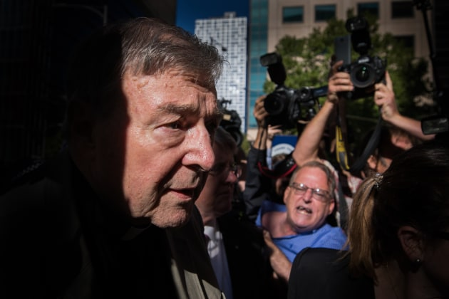 © Jason South. Pell. Running the gauntlet: Cardinal George Pell runs the gauntlet of media and angry christians at the Melbourne County Court before hearing his sentence .