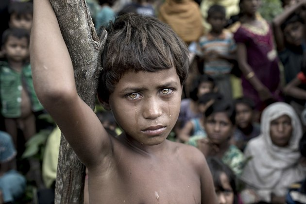 © K M Asad. Battle Victim. SIPA Photo of the Year. In Cox's Bazar, Asmat Ara looks clearly traumatized after the recent violence which took place in Myanmar, on September 6th, 2017. The previous night she had entered Tenkhali Rohingya refugee camp with her family from Kumar Khali, Myanmar Rohingya state. According to the UNHCR, more than 646,000 Rohingya refugees have fled from Myanmar since August 25th, 2017, most of them trying to cross the border to reach Bangladesh.