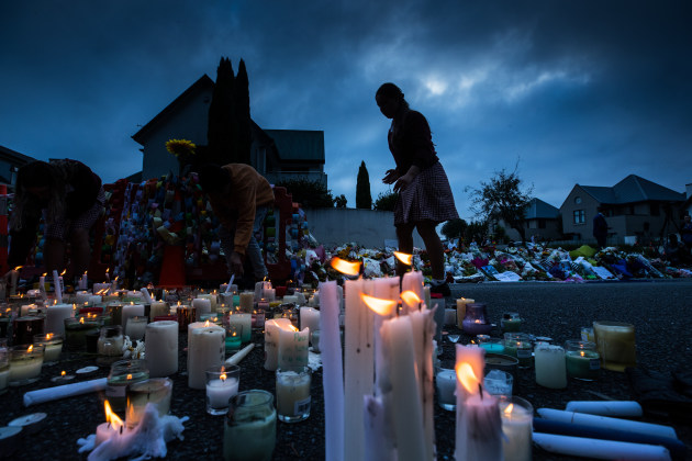 © Jason South. Christchurch Massacre. School students light hundreds of candles at a makeshift shrine of for the victims of the Christchurch Mosque Shootings.