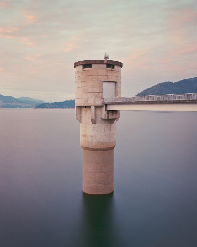 Intake tower, Blowering Reservoir, NSW, Australia. This image is part of an ongoing project concerning the Snowy Hydro Scheme and the Snowy Mountains region in NSW. It's an exploration of the balance between nature and man's intervention upon it - vast structures amongst epic landscapes, re-shaped waterways and newly created ones. This is the Blowering Reservoir intake tower taken in the early morning light, using a Pentax 67 medium format camera and Portra160NC film. The brutalist structure creates an interesting juxtaposition with the surrounding environment and the soft-looking water – a result of the need for a long exposure. © Chris Round, Australia, Commended, Open Architecture. Winner, Australia National Award, 2018 Sony World Photography Awards.