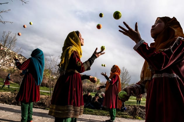 Kabul, 2016. A group of Afghan girls juggle tennis balls in the streets of the capital.