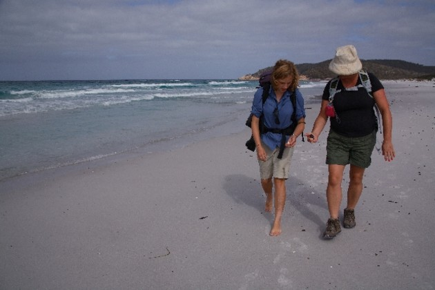 Walkers examine sea treasures found on the long, pristine stretch of Friendly Beach. Photo: Gabi Mocatta.