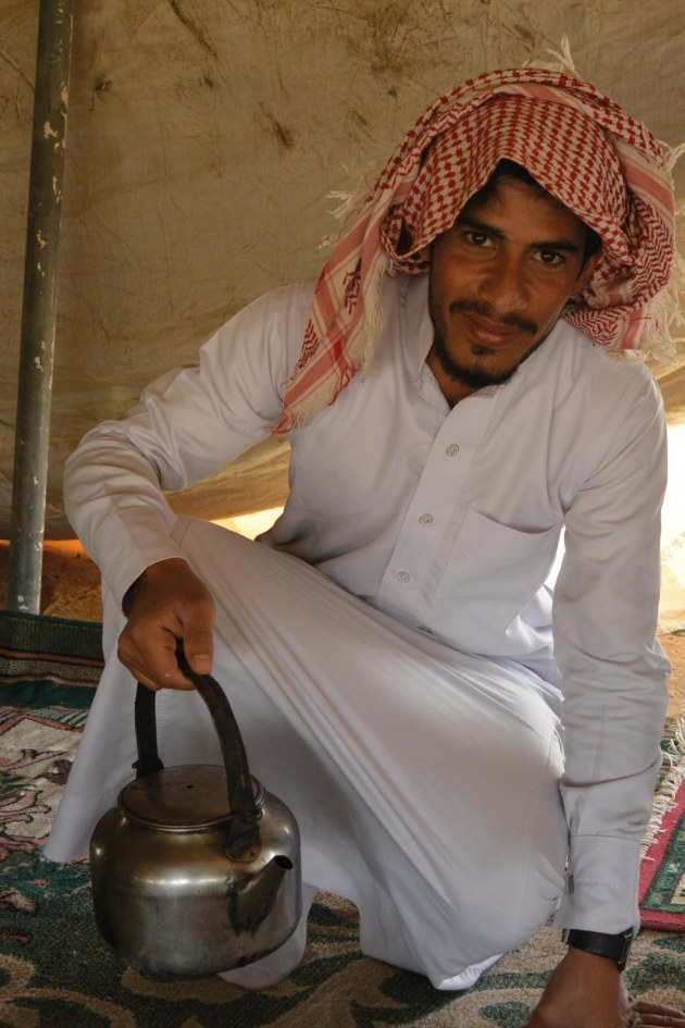 Abu Sabbah's son offers tea at their Bedouin camp en route to Wadi Rum
