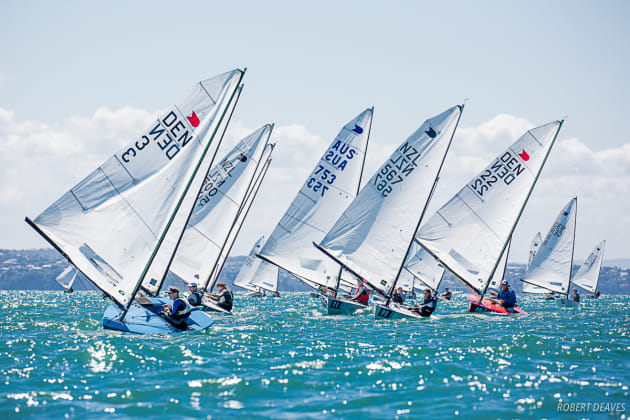 Race 1 of the OK Dinghy Worlds 2019 downwind. Photo Robert Deaves.