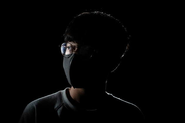 © Chung Ming Ko, Hong Kong, Category Winner, Professional, Documentary, 2020 Sony World Photography Awards. Wounds of Hong Kong 7. Chu, a 17-year-old Hong Kong Diploma of Secondary Education Examination (DSE) student, was hit by a police baton while taking part in a human chain at Tai Po Station, Hong Kong, on 7 September 2019. He was seen lying in his own blood on cable TV. Chu's head needed stitches and the phalanx of the little finger on his right hand was broken, requiring six bone screws. He has decided to postpone his DSE for a year in order to tackle his PTSD (post-traumatic stress disorder).