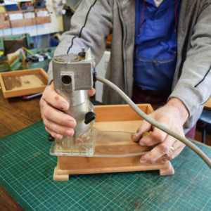 Showing Steve Hay's custom made palm router base in use.