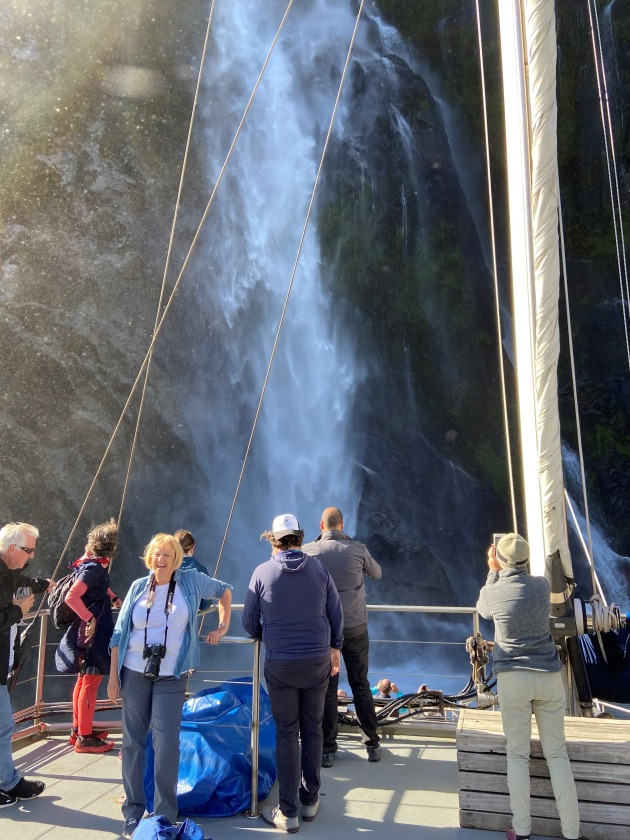 Happy hikers enjoying the close encounters with Milford Sounds many waterfalls.