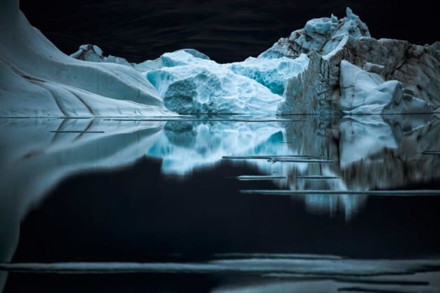 A quiet night on Ellesmere Island, in twenty-four hours of daylight. The high density of the cold water coupled by the high mass of its salt content makes for mirror-like reflections. Ellesmere Island, Canadian Arctic, 2008. © Sebastian Copeland.