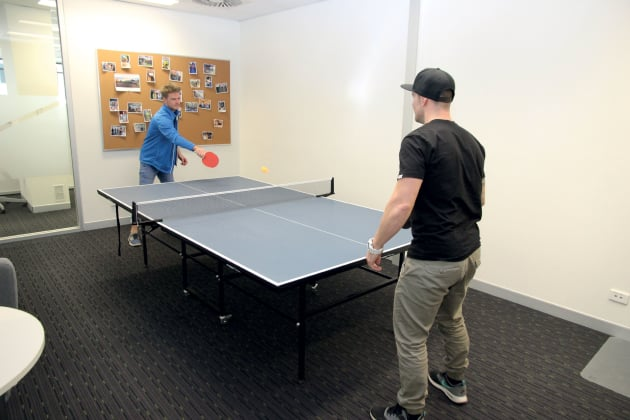 Customer Service & Sales staffer Matt Etherington (in blue) and BMX Product Manager Corey Stafford take a break in Advance Traders' lunch and recreation area.