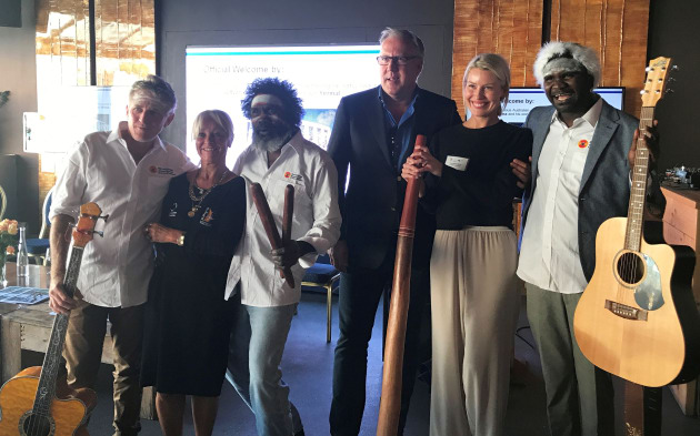 The Superyacht Australia breakfast featured a performance by former Yothu Yindi members Stuart Kellaway (left) and Witiyana Marika (third from left) with Witiyana's son, Yirrmal (right), pictured here with (l-r) MaryAnne Edwards, AIMEX CEO, Martin Redmayne, MC, and Courtney Barry, Tourism Australia.
