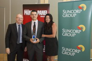 Brenda and Chris Gosney accept Best Customer Experience Award from Suncorp's Simon Grant