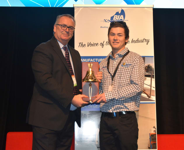 BIAV president Mark Crockford presents the BIAV Apprentice Of The Year Award to Dougie Bauer at the Melbourne Boat Show.