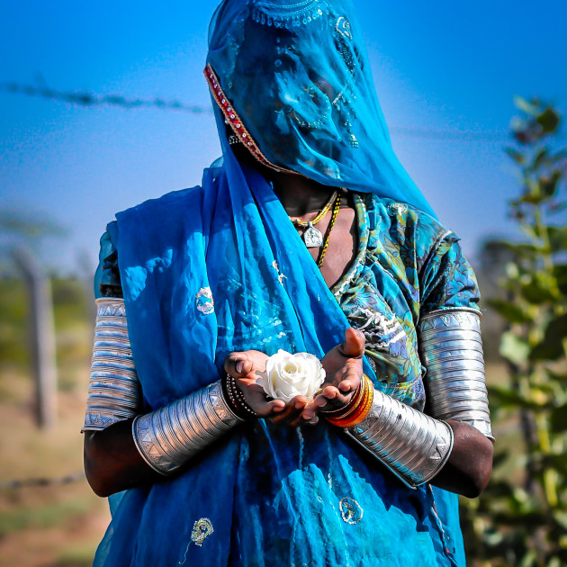 Bound. Rajasthan 2013. Only dry dusty roads till the next location. Miles and miles and miles from anywhere. Our lady in blue is working the land. A hard labourer, under the guidance of male 'handlers' from sun up to sun down. Dressed as beautifully as this everyday.