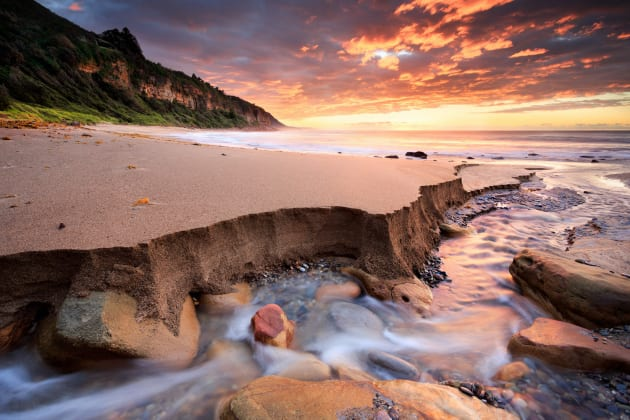 Coalcliff Beach, Illawarra, NSW. Visiting this location for sunrise I had originally planned to photograph the rock pool. However, the creek in the distance caught my eye so I went over to investigate. Getting low down I was able to accentuate the sand walls created by creek, and it was all topped off with a stunning sunrise! Canon 5D Mark III, Canon 17-40 f/4L, 2 sec @ f/13, tripod