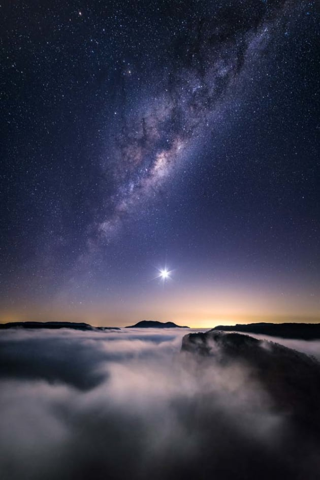 I got up early one March morning to photograph the moon rising over Mount Banks in the Blue Mountains, NSW. Luckily there was a beautiful cloud inversion in the Grose Valley and the moon wasn't so bright that it washed out the Milky Way. Sony A7RII, Samyang 14mm f/2.8 lens, 20s @ f/2.8, ISO 2500, tripod. Median stacked in Adobe Photoshop.