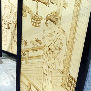 Screen with pyrography by Neville Pike and Alyssa Willstrop.