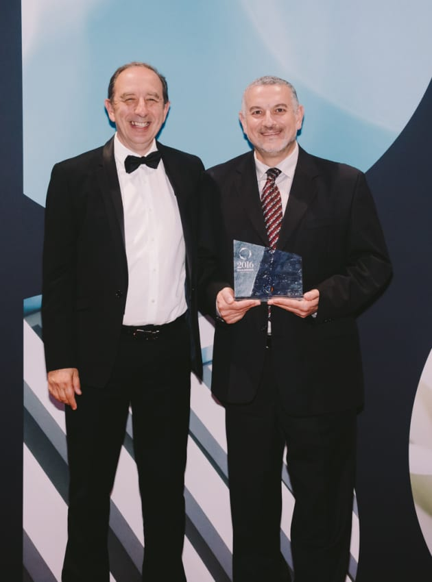 Domenic Genua receives the EEAA President's award from Spiro Anemogiannis, EEAA president.
