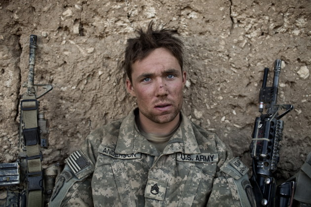 US Army Sergeant Anderson sits at a temporary patrol base after a patrol in the Tangi Valley, Wardak Province, Afghanistan, on September 11, 2009. Australian Adam Ferguson's images from wars in Iraq and Afghanistan were some of the finest documentary images we saw this year. © Adam Ferguson
