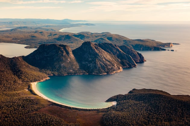 Wineglass Bay and the Hazards, Freycinet National Park, Tasmania. Having photographed the region extensively from the ground, a sunrise flight over Freycinet opened up a new world of photographic possibilities. I was captivated by the scene of the Hazards emerging from the ocean, with Wineglass Bay in the foreground. Canon 5DSR, Canon 24-70mm f/2.8 II, 1/1000 sec @ f/4, ISO 200, handheld.