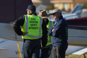 Former GA Task Force boss Peter John speaks with CASA colleagues at Ausfly in 2012. (Steve Hitchen)
