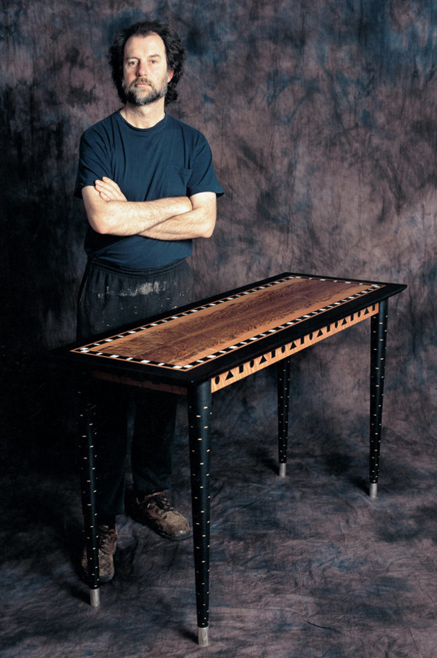 Greg Collins with one of his tables. Some of the timber species he uses for his coloured inlay work include lignum vitae, medicine wood, pink ivorywood, cocobolo, Indian rosewood, kingwood, black palm, ebony, purpleheart and tagua nut. Photo: Steven Blakeney