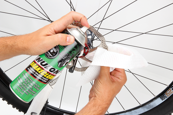 <p>Oil is a disc brake's worst enemy. Always keep some disc brake cleaner in with your bike tools. Clean the rotors immediately if you accidently touch them with oily hands or drip lube on them. It's also worth giving them an occasional clean to remove contaminants that can come from the trail.</p>