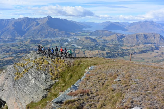 Only 1,100 metres of vertical descent to go—our crew at the top of Coronet Peak.