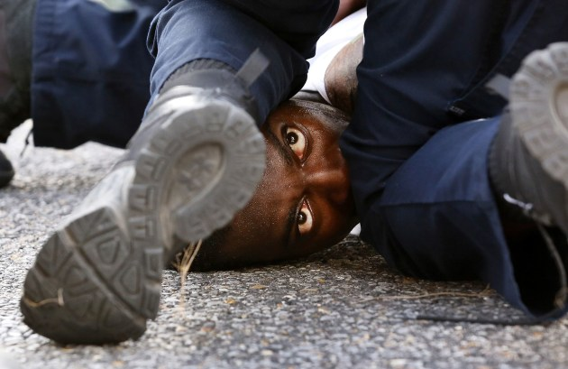 © Jonathan Bachman. First place - General Colour. A man is detained while protesting the death of Alton Sterling in Baton Rouge, Louisiana, U.S. July 9, 2016. Alton Sterling, a 37 year old black man was shot at close range while being held down by two white police officers. The shooting, captured on cell phone videos, aggravated the unrest that has occurred through the United States for two years over the use of excessive force by police, especially against black men.