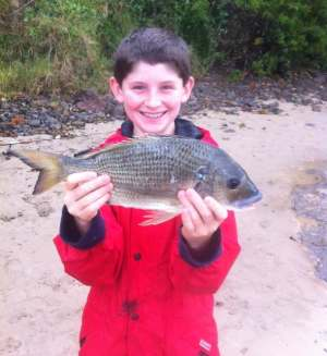 Henry Jenkinson with a good sized bream he caught near Kiama on the NSW South Coast.