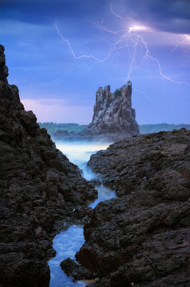 "'Ancient of Days' ""One of the most memorable moments I've had behind the camera and the one shot I'd hoped to get in my lifetime,"" says Patino."" Crouched beneath an umbrella and almost about to give up and run for cover, a bolt of lightning finally breaks behind the weathered spire at Cathedral Rocks, Kiama. Sony A7R, Sony 55mm f/1.8 lens. 30s @ f10, ISO 200, tripod."