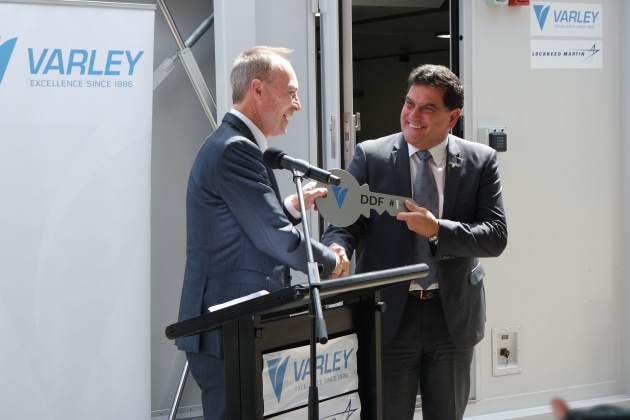 Lockheed Martin Australia CEO Vince Di Pietro (R) with Jeff Phillips, MD Varley Group, mark the official handover of the first two F-35 deployable facilities manufactured by Varley Group. Credit: Lockheed Martin Australia
