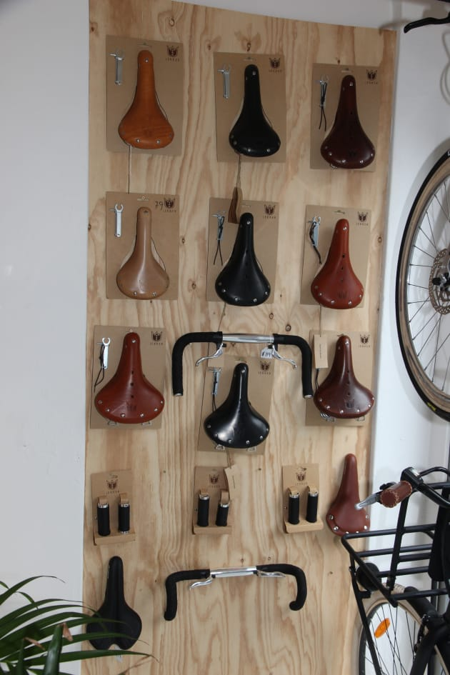At first glance you might think they've got a display of Brooks leather saddles, but these are all Lekker branded parts.