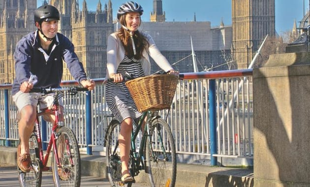The amount of cycling is set to double in the UK thanks to funding decisions that have been made in the Houses of Parliament, seen in the background of this photo.