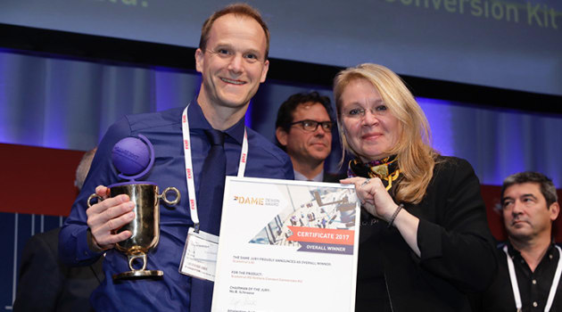 Birgit Schnaase, chairwoman of the DAME Awards jury, presents the best overall prize to Tom Reed of Scanstrut.