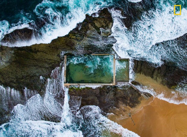 Photograph by Todd Kennedy, 2017 National Geographic Nature Photographer of the Year. In Sydney, Australia, the Pacific Ocean at high tide breaks over a natural rock pool enlarged in the 1930s. Avoiding the crowds at the city's many beaches, a local swims laps.