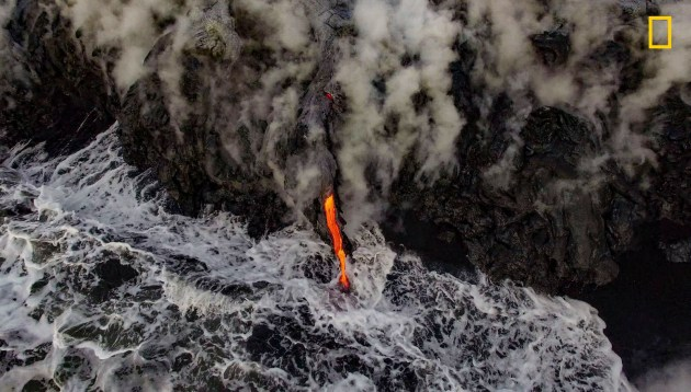 Photograph by Greg C., 2017 National Geographic Nature Photographer of the Year. On the flanks of Kilauea Volcano, Hawai'i, the world's only lava ocean entry spills molten rock into the Pacific Ocean. After erupting in early 2016,the lava flow took about two months to reach the sea, six miles away.