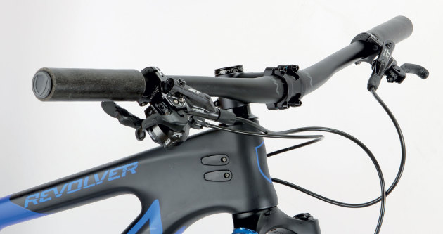 Wide bars and a short stem; not your traditional XC race setup but it works on the Revolver.