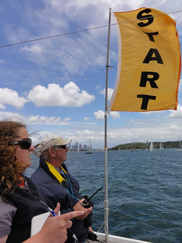 Phil and Melissa Yeomans on board the Middle Harbour Yacht Club start boat.