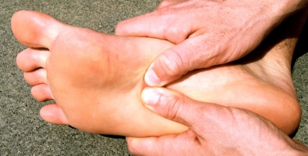 Massaging a foot with plantar fasciitis.