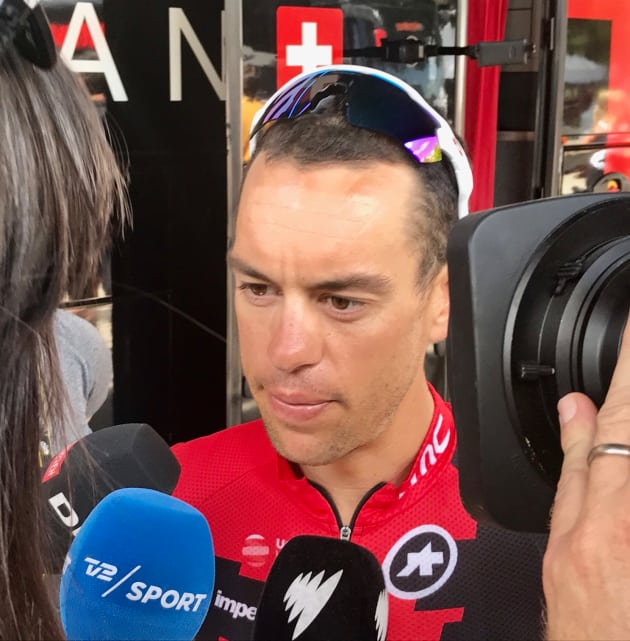 Richie Porte of BMC Racing Team speaks with reporters at the start of Stage 8 in Dole. Today's Stage 9 will be critical for Ritchie & the team's Tour. Image: Nat Bromhead.