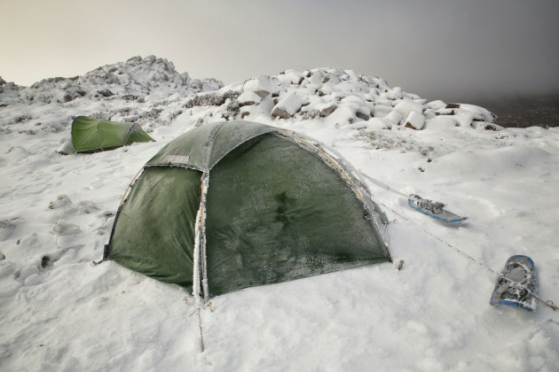 Pitching tents on the edge of the Rodway Valley on a snow shoe trip, saw temperatures reaching -18°C with wind chill factor. Tasmania July 2017.