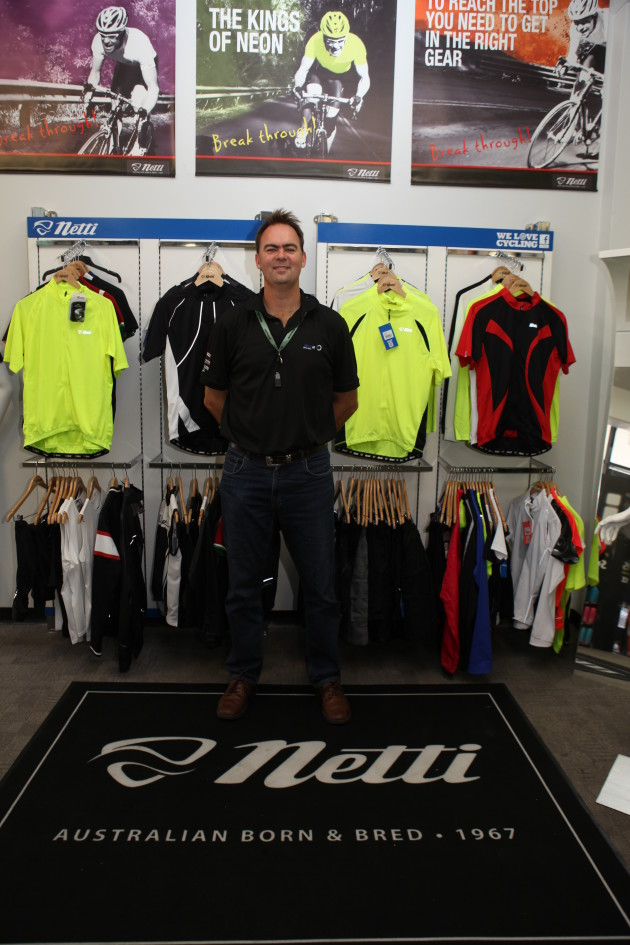 SOLA Sport CEO George Nisbet proudly displays a sample of Netti's 2015 product range and marketing material.
