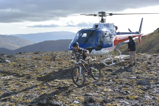 Well that was easy. Leigh unloads the bikes after the 1,500 metre climb up the Remarkables.